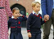 <p>The royal siblings look a little nervous as they take in the school entrance. </p>