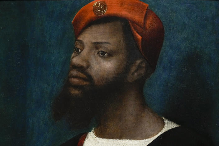 """Detail of a painting by Jan Mostaert, titled Portrait of an African Man, painted around 1525-1530, during a press preview of the Remember Me exhibit which brings together international masterpieces of portraiture at the Rijksmuseum in Amsterdam, Netherlands, Tuesday, Sept. 28, 2021. As COVID-19 lockdowns ease and borders reopen, there is a gathering at Amsterdam's Rijksmuseum of people from around Europe, depicted in more than 100 Renaissance portraits. The Dutch national museum's new exhibition """"Remember Me,"""" covers the century 1470-1570. (AP Photo/Peter Dejong)"""