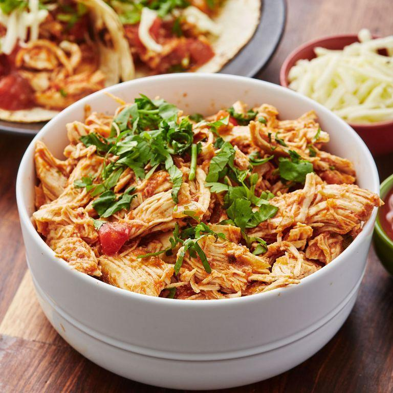 """<p>This is probably THE simplest recipe ... ever? A <a href=""""https://www.delish.com/uk/cooking/recipes/g30220431/slow-cooker-recipes/"""" rel=""""nofollow noopener"""" target=""""_blank"""" data-ylk=""""slk:slow cooker meal"""" class=""""link rapid-noclick-resp"""">slow cooker meal</a> made with only 4 ingredients is really something to celebrate. The chicken falls apart and becomes immensely tender, flavoured with the familiar flavours of chunky salsa and taco seasoning, and brightened up with bursts of lime juice. Serve this over rice, in lettuce cups, or as tacos. This recipe is the epitome of set it and forget it.</p><p>Get the <a href=""""https://www.delish.com/uk/cooking/recipes/a30725169/crockpot-salsa-chicken-recipe/"""" rel=""""nofollow noopener"""" target=""""_blank"""" data-ylk=""""slk:Slow Cooker Salsa Chicken"""" class=""""link rapid-noclick-resp"""">Slow Cooker Salsa Chicken</a> recipe.</p>"""
