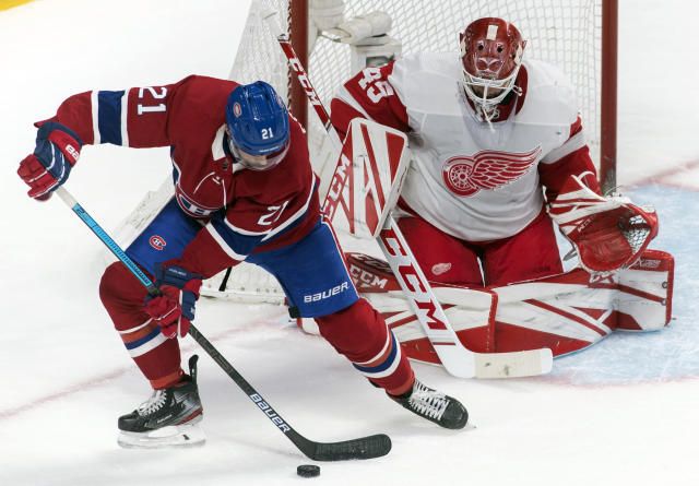 Montreal Canadiens' Nick Cousins moves in on Detroit Red Wings goaltender Jonathan Bernier during the first period of an NHL hockey game, Saturday, Dec. 14, 2019, in Montreal. (Graham Hughes/The Canadian Press via AP)