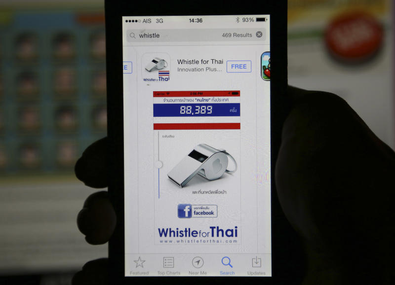 """Nok Weed, or Whistle app, is shown after being downloaded on a smartphone Friday, Dec. 13, 2013 in Bangkok, Thailand. More than 70,000 people have downloaded one application that mimics the shrieking sound of a whistle - the symbol of the """"whistle-blowing campaign"""" against Prime Minister Yingluck Shinawatra. The new app is called """"Nok Weed"""" and it lets users choose the color of their whistle, adjust the volume and then tap the screen to sound it. (AP Photo/Apichart Weerawong)"""