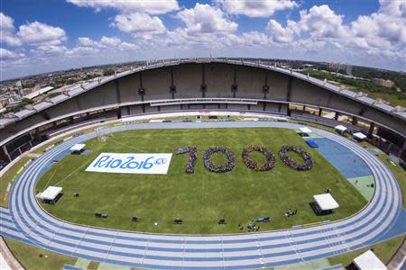 Young athletes stand in formation to celebrate 1000-day countdown to the opening of the Rio 2016 Olympic Games, in Belem