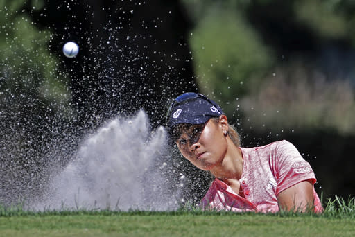 Danielle Kang hits out of a green side bunker on the first hole during the third round of the Marathon Classic LPGA golf tournament Saturday, Aug. 8, 2020, at the Highland Meadows Golf Club in Sylvania, Ohio. (AP Photo/Gene J. Puskar)