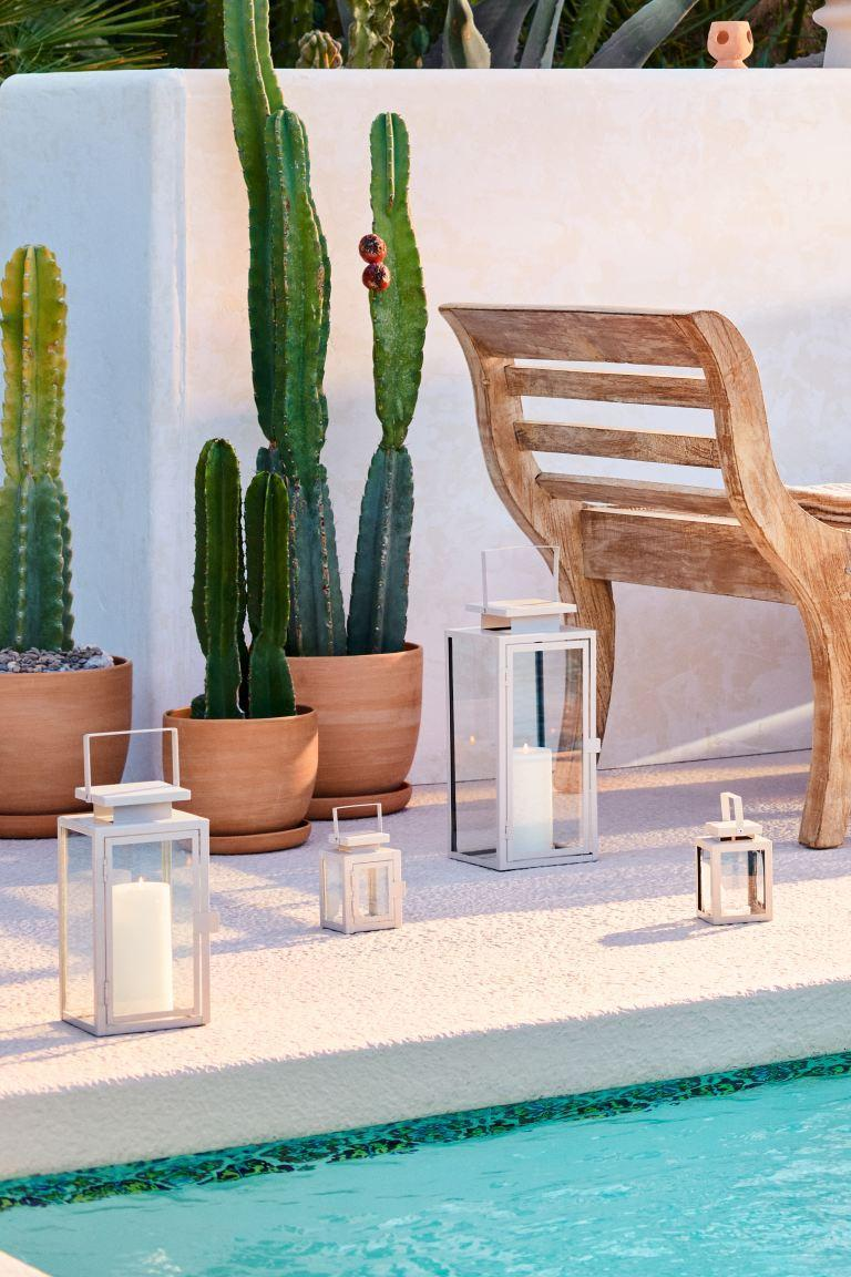 """<strong>Maybelle Morgan, Entertainment Editor</strong><br><br><strong>Under £10</strong><br><br>Since moving house to somewhere with actual outdoor space, there's nothing more satisfying than watching the evenings creep in and four of these little lanterns flickering in the dark.<br><br><strong>H&M</strong> Small metal candle lantern, $, available at <a href=""""https://www2.hm.com/en_gb/productpage.0962246001.html"""" rel=""""nofollow noopener"""" target=""""_blank"""" data-ylk=""""slk:H&M"""" class=""""link rapid-noclick-resp"""">H&M</a>"""