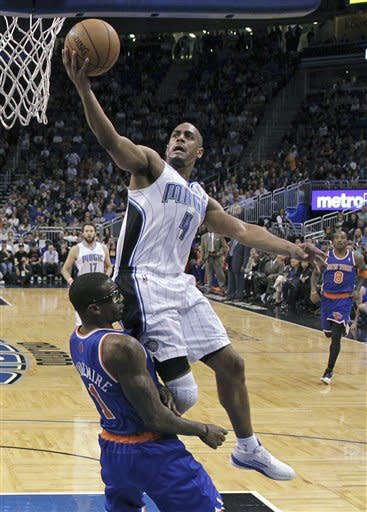 Orlando Magic's Arron Afflalo (4) runs into New York Knicks' Amare Stoudemire (1) while going up for a shot during the first half of an NBA basketball game, Saturday, Jan. 5, 2013, in Orlando, Fla. Afflalo was called for charging. (AP Photo/John Raoux)