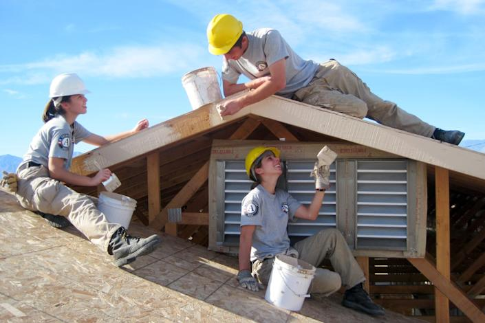 "AmeriCorps volunteers work on a roof project. For people wanting to take a gap year, there are opportunities for adventure available through various organizations, along with the possibility for housing and paid work. <span class=""copyright"">(AmeriCorps)</span>"