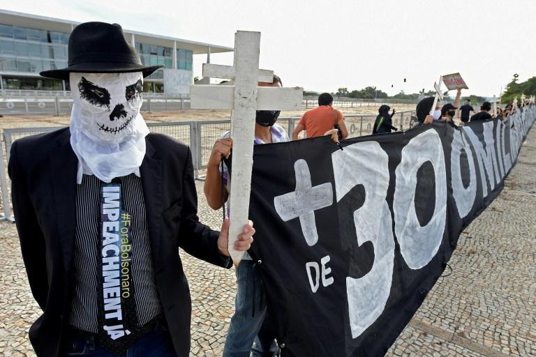 A demonstrator decries Brazil's high Covid-19 death toll as he protests against the government of President Jair Bolsonaro in Brasilia in March 2021