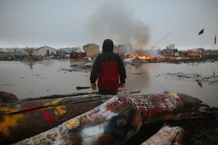 A demonstrator at the encampment opposing the construction of the Dakota Access Pipeline in February 2017 as federal officials ordered activists to leave. (Photo: Stephen Yang via Getty Images)