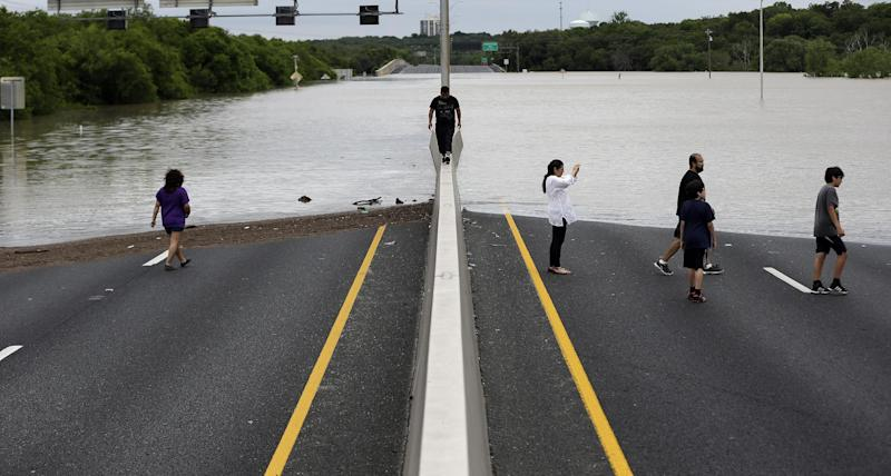 Flood waters cover eight lanes of Highway 281, Saturday, May 25, 2013, in San Antonio.  The San Antonio International Airport by Saturday afternoon had recorded nearly 10 inches of rain since midnight.  (AP Photo/Eric Gay)