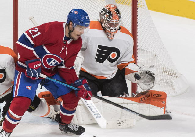 Montreal Canadiens' Nick Cousins moves in on Philadelphia Flyers goaltender Brian Elliott during second period NHL hockey action in Montreal, Saturday, Nov. 30, 2019. (Graham Hughes/The Canadian Press via AP)