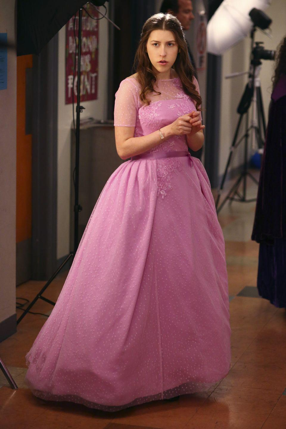 "<p>A faulty cheese machine prevented Sue from attending prom, but before the fiasco, she was ready for the dance in a sweet bubblegum pink ball gown. </p><p><a class=""link rapid-noclick-resp"" href=""https://www.amazon.com/Middle-Complete-First-Season/dp/B004FS1ZRA?tag=syn-yahoo-20&ascsubtag=%5Bartid%7C10063.g.36197518%5Bsrc%7Cyahoo-us"" rel=""nofollow noopener"" target=""_blank"" data-ylk=""slk:STREAM NOW"">STREAM NOW</a></p>"