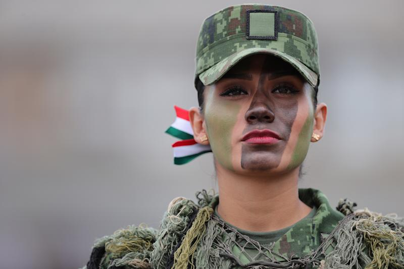 VARIOUS CITIES, MEXICO - SEPTEMBER 16: Mexican soldier poses during the Independence Day military parade at Zocalo Square on September 16, 2020 in Various Cities, Mexico. This year El Zocalo remains closed for general public due to coronavirus restrictions. Every September 16 Mexico celebrates the beginning of the revolution uprising of 1810. (Photo by Hector Vivas/Getty Images)