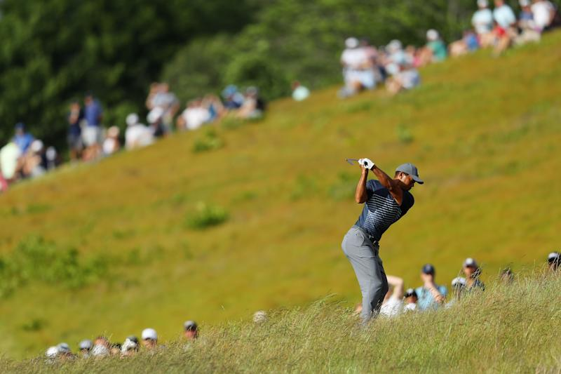 Dustin Johnson stretches U.S. Open lead, Tiger misses cut