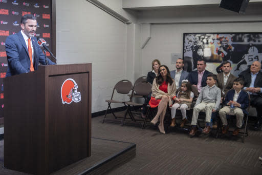 Cleveland Browns new NFL football head coach Kevin Stefanski answers a question during a news conference as his family listens, at FirstEnergy Stadium in Cleveland, Tuesday, Jan. 14, 2020. (AP Photo/Phil Long)