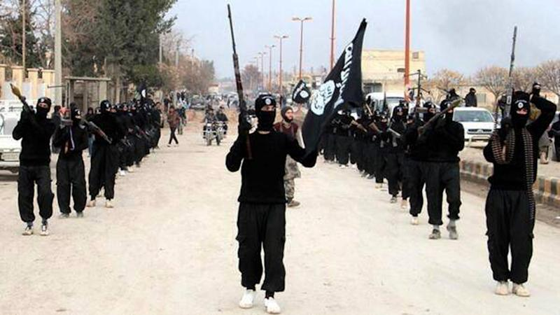 This undated image posted on a militant website on Tuesday, Jan. 14, 2014 shows fighters from the al-Qaida linked Islamic State of Iraq and the Levant (ISIL) marching in Raqqa, Syria. Two weeks of fighting between an al-Qaida-linked group and other rebel forces in Syria has killed more than 1,000 people, an activist group said Thursday, as clashes raged between the rival factions in a northwestern town. The fighting pitting the al-Qaida-linked Islamic State of Iraq and the Levant and other groups are the most serious among rebel forces since the Syrian conflict began in March 2011. (AP Photo/militant website)