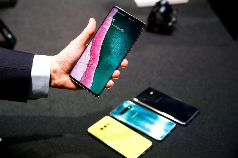 FILE PHOTO: A journalist holds the new Samsung Galaxy S10 smartphone at a press event in London