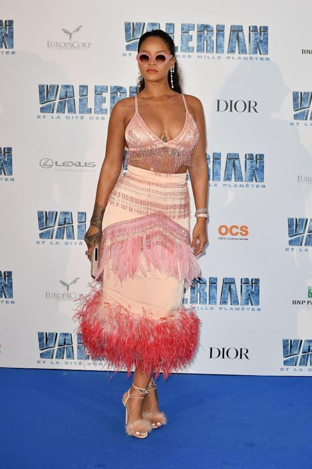 <p>Rihanna wore a decorated pink look to the premiere of <em>Valerian and the City of a Thousand Planets</em>, including a pink bra with beaded fringe. (Photo: Getty Images) </p>