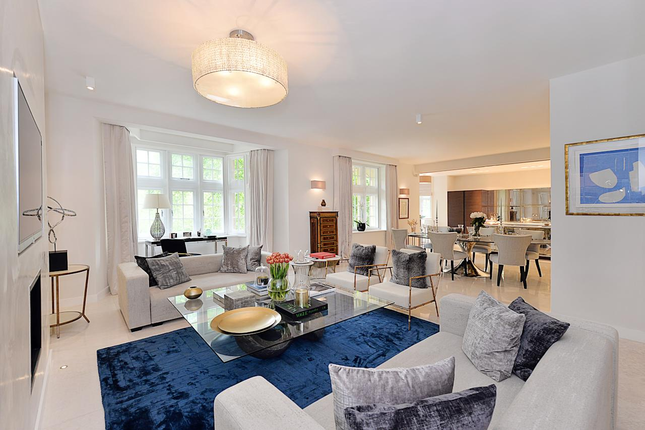 <p>Staff will share a 2,400 sq ft four bedroom flat, including this lavish living room. </p>