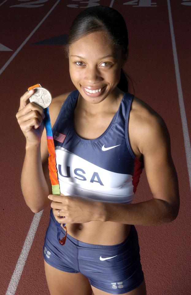 Allyson Felix of the United States poses with 2004 Athens Olympic Track & Field silver medal in the 200 meters. (Photo by Kirby Lee/WireImage)