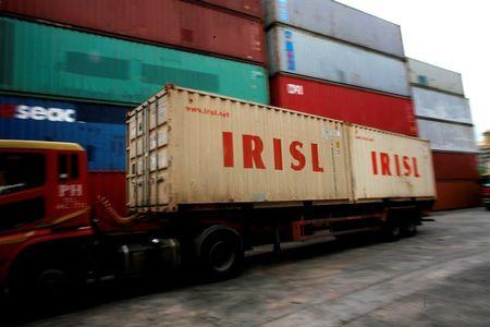 FILE PHOTO: A truck carrying IRISL containers arrives a depot in northern Singapore