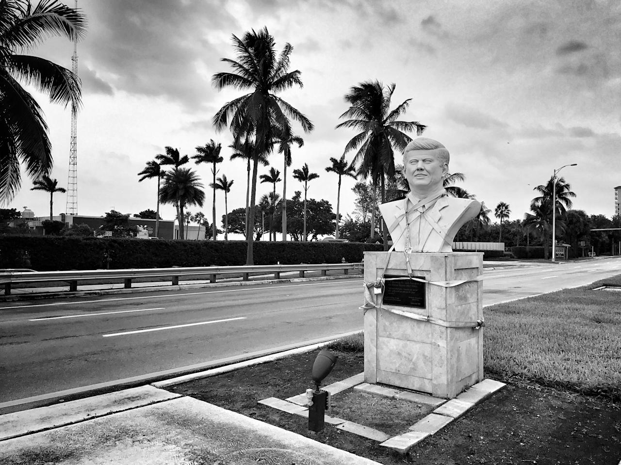 <p>A roadside bust of JFK is strapped down ahead of the arrival of Hurricane Irma Saturday in North Bay Village, Fla. (Photo: Holly Bailey/Yahoo News) </p>