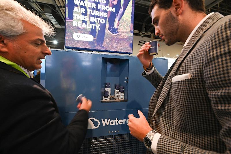 Attendees at CES 2019 in Las Vegas taste water created from the air by the Watergen GEN-350 device (AFP Photo/Robyn Beck)