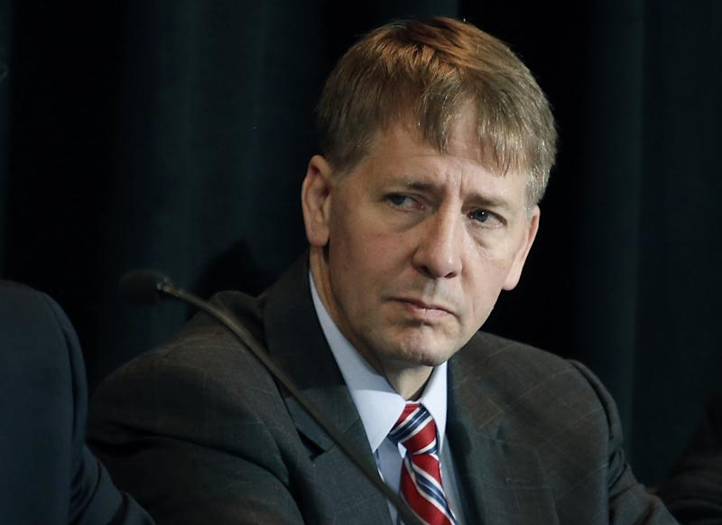 <p> FILE - In this Wednesday, Oct. 7, 2015, file photo, Consumer Financial Protection Bureau Director Richard Cordray listens to a speaker during a a hearing in Denver. State and federal authorities are suing Ocwen Financial Corp., saying the mortgage servicing company botched the handling of millions of mortgage accounts. The Consumer Financial Protection Bureau said Thursday, April 20, 2017, that Ocwen generated errors in borrowers' accounts, failed to credit payments, illegally foreclosed on homeowners, and charged borrowers for add-on products without their consent. Ocwen is one of the nation's largest non-bank mortgage lenders. (AP Photo/Brennan Linsley, File) </p>