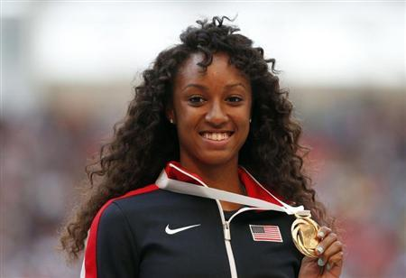 Gold medallist Brianna Rollins of the U.S. poses during the victory ceremony for the women's 100 metres hurdles at the IAAF World Athletics Championships at the Luzhniki stadium in Moscow August 18, 2013. REUTERS/Grigory Dukor