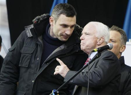U.S. Senator McCain speaks with Ukrainian opposition leader Klitschko during a mass rally by pro-European integration protesters at Independence Square in Kiev