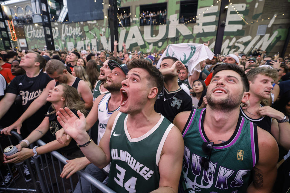 Fans watch Game 6 of the NBA basketball finals between the Milwaukee Bucks and the Phoenix Suns Tuesday, July 20, 2021, in Milwaukee. (AP Photo/Jeffrey Phelps)