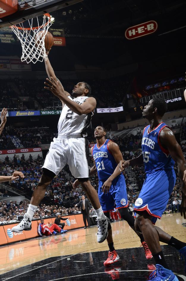 SAN ANTONIO, TX - March 24: Kawhi Leonard #2 of the San Antonio Spurs goes up for a shot against the Philadelphia 76ers at the AT&T Center on March 24, 2014 in San Antonio, Texas