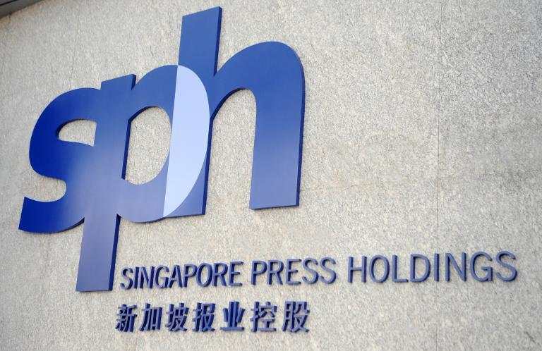 A new Singapore Press Holdings (SPH) logo is unveiled at a ceremony marking the company's 25th anniversary in Singapore on March 30, 2009