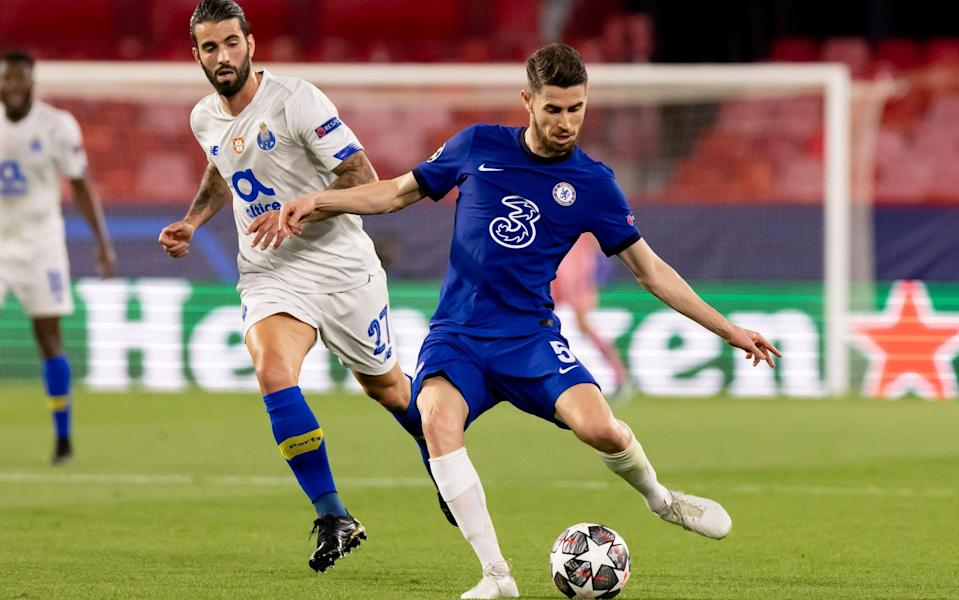 Sergio Oliveira of FC Porto and Jorginho of Chelsea FC battle for the ball during the UEFA Champions League Quarter Final Second Leg match between Chelsea FC and FC Porto at Estadio Ramon Sanchez Pizjuan on April 13, 2021 in Seville, Spain. Sporting stadiums around Spain remain under strict restrictions due to the Coronavirus Pandemic as Government social distancing laws prohibit fans inside venues resulting in games being played behind closed doors - Getty Images/DeFodi Images