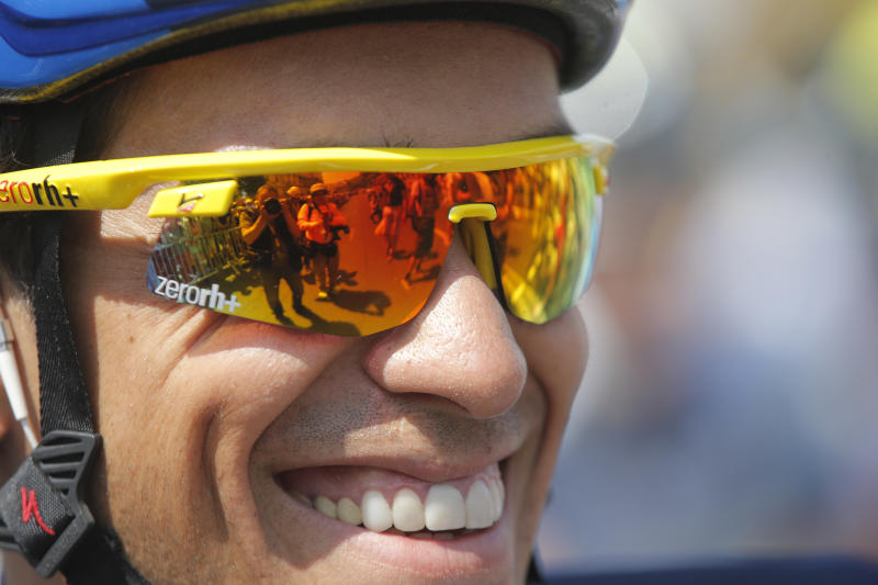 Spain's Alberto Contador smiles prior to the start of the thirteenth stage of the Tour de France cycling race over 173 kilometers (108.1 miles) with start in in Tours and finish in Saint-Amand-Montrond, western France, Friday July 12 2013. (AP Photo/Christophe Ena)