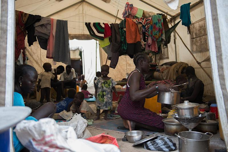 A woman prepares food in an IDP (Internaly Displaced Persons) shelter in the UNMISS camp in Juba on June 20, 2014