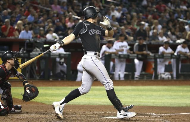 Colorado Rockies' Ryan McMahon watches his two-run double against the Arizona Diamondbacks during the seventh inning of a baseball game Wednesday, June 19, 2019, in Phoenix. (AP Photo/Ross D. Franklin)