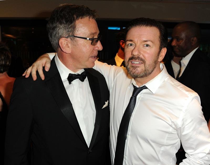 Tim Allen (left) and Ricky Gervais (right) pose wearing black tie attire