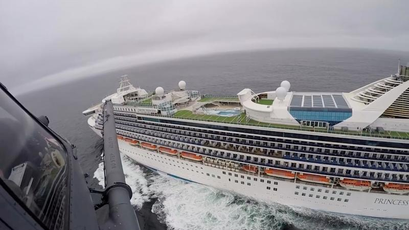 Airmen from the Moffett Federal Airfield based, 129th Rescue Wing deliver coronavirus test-kits to the Grand Princess cruise ship off the coast of California, U.S. in this still image from a handout video obtained by Reuters on March 5, 2020. California National Guard/Handout via REUTERS ATTENTION EDITORS - THIS IMAGE WAS PROVIDED BY A THIRD PARTY. TPX IMAGES OF THE DAY
