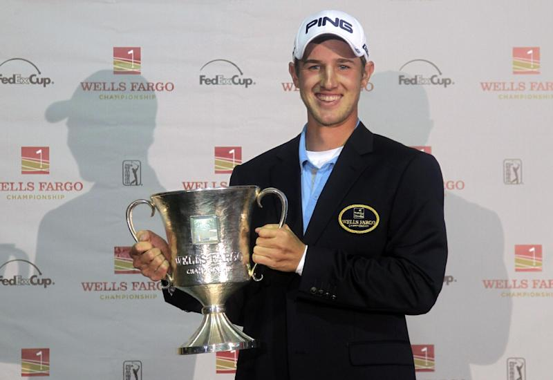 Golfer Derek Ernst poses with the trophy after winning the Wells Fargo Championship golf tournament at Quail Hollow Club in Charlotte, N.C., Sunday, May 5, 2013. (AP Photo/Bob Leverone)