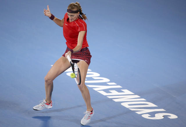 Petra Kvitova of Czech Republic hits a forehand to Aliaksandra Sasnovich of Belarus during their women's singles semifinal match at the Sydney International tennis tournament in Sydney, Saturday, Jan. 12, 2019. (AP Photo/Rick Rycroft)