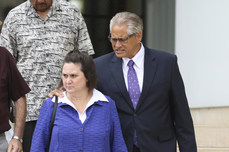 Former Honolulu police chief Louis Kealoha, right, and his wife, former deputy prosecutor Katherine Kealoha, left, walk out of federal court in Honolulu on Tuesday, June 25, 2019. Prosecutors say the couple abused their positions in an attempt to silence a relative who could have exposed the financial fraud that funded their lavish lifestyle. Closing arguments were being held Tuesday in the conspiracy trial against the Kealoha's, considered the largest public corruption trial ever in Hawaii. (AP Photo/Caleb Jones)