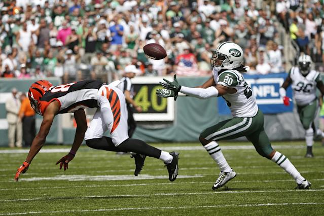 <p>New York Jets defensive back Marcus Williams (20) intercepts a pass to Cincinnati Bengals' Tyler Boyd (83) during the first half of an NFL football game Sunday, Sept. 11, 2016 in East Rutherford, N.J. (AP Photo/Kathy Willens) </p>