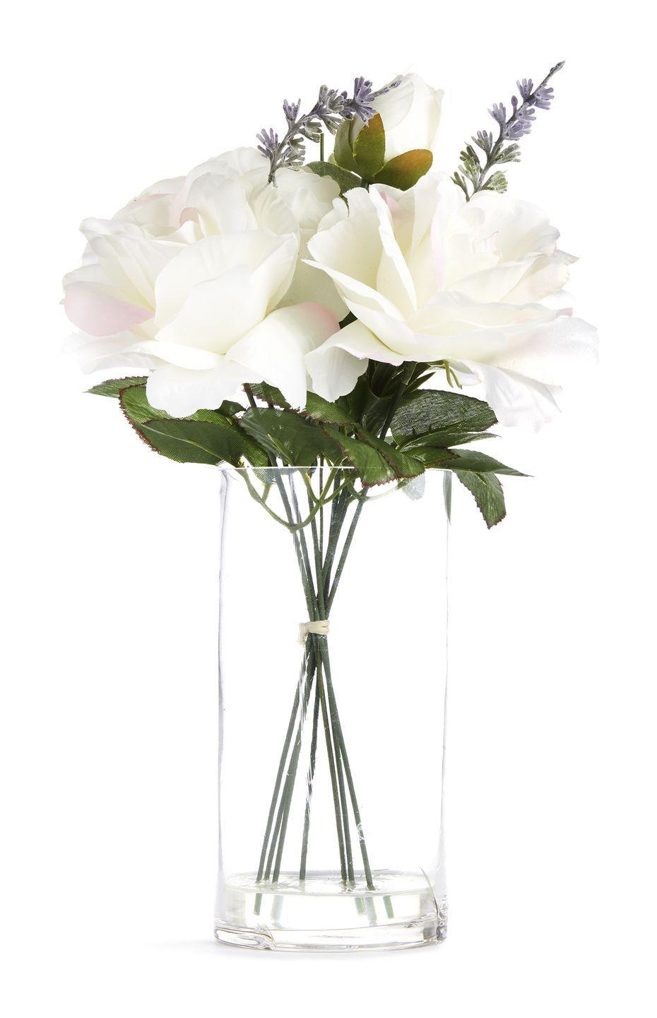 <p>Large glass vase with faux white flowers, £8.00</p>