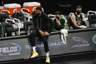 Milwaukee Bucks' Giannis Antetokounmpo watches from the bench during the second half of an NBA basketball game against the Charlotte Hornets Friday, April 9, 2021, in Milwaukee. Antetokounmpo didn't play because of an injury. (AP Photo/Morry Gash)