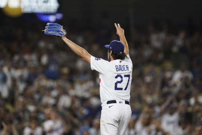 Los Angeles Dodgers' Trevor Bauer celebrates after striking out San Francisco Giants' Darin Ruf to end the sixth inning of a baseball game, Monday, June 28, 2021, in Los Angeles. (AP Photo/Jae C. Hong)