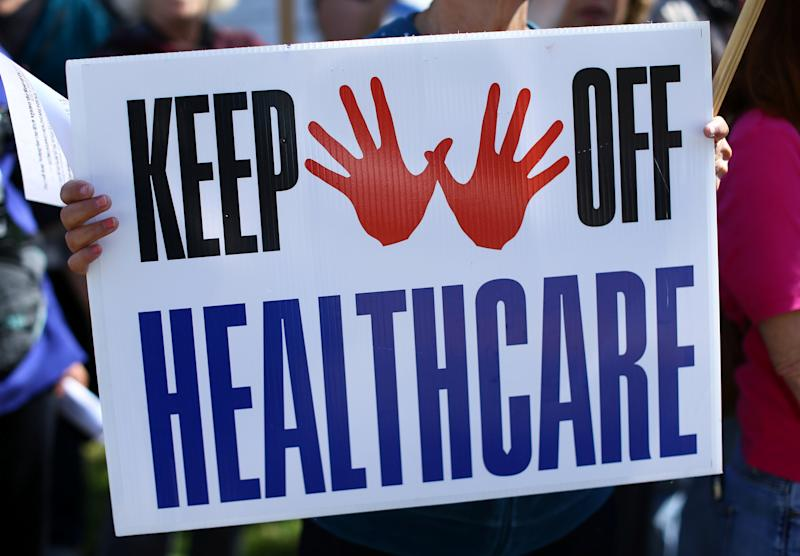 Demonstrators protest over the repeal and replacement of Obamacare outside the offices of Republican congressman Darryl Issa in Vista, California, U.S., March 7, 2017.    REUTERS/Mike Blake