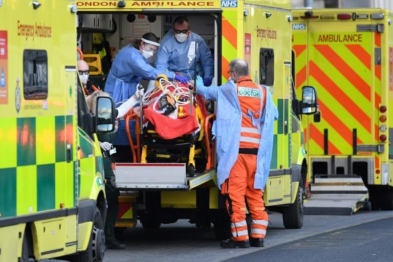 London ambulance staff stretcher a patient into the Royal London Hospital in the east of the city