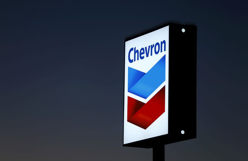 FILE PHOTO: FILE PHOTO: A Chevron gas station sign in Cardiff, California