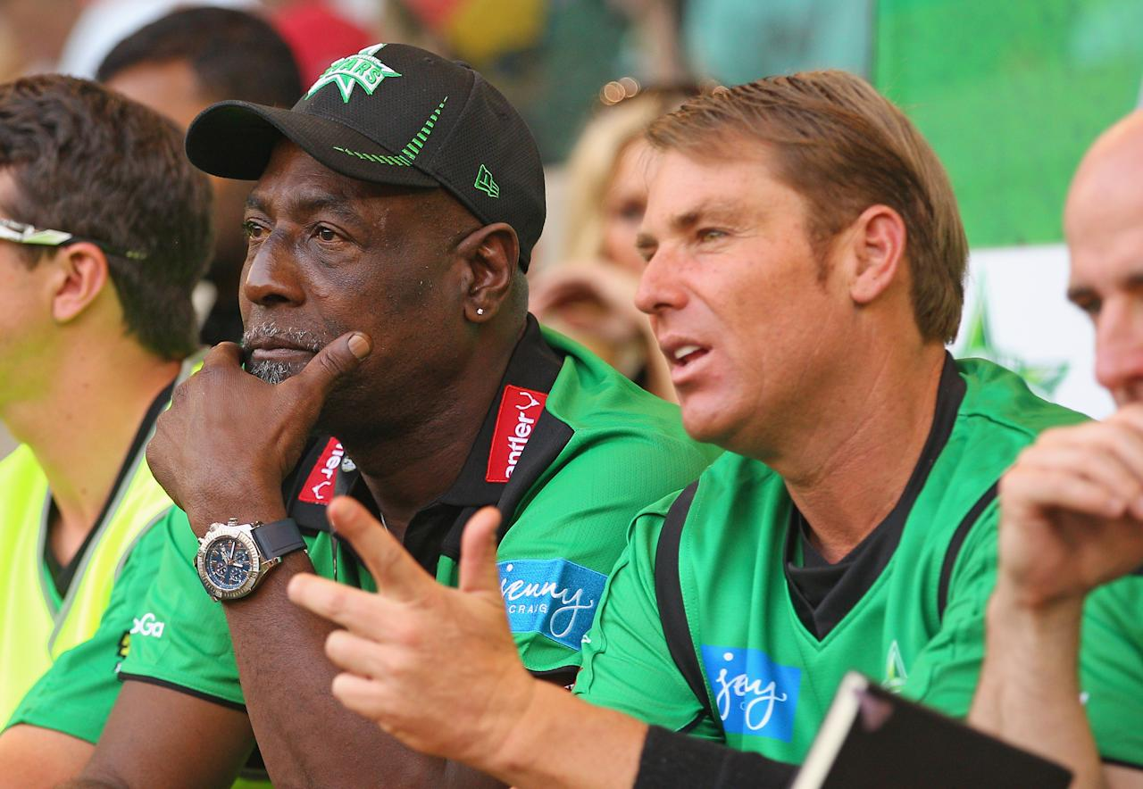 MELBOURNE, AUSTRALIA - DECEMBER 07:  Melbourne Stars captain Shane Warne and Stars Ambassador Viv Richards look on during the Big Bash League match between the Melbourne Renegades and the Melbourne Stars at Etihad Stadium on December 7, 2012 in Melbourne, Australia.  (Photo by Scott Barbour/Getty Images)