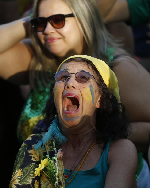 <p>A Brazil soccer fan reacts as Belgium scores during a live telecast of the Brazil vs. Belgium World Cup quarter finals soccer match, in Rio de Janeiro, Brazil, Friday, July 6, 2018. (AP Photo/Silvia Izquierdo) </p>